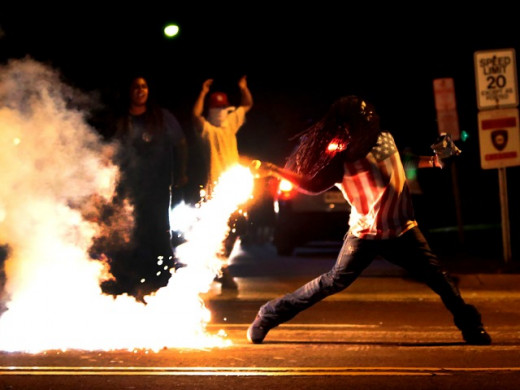 Rioters throwing Molotov cocktails at police in Ferguson Missouri.
