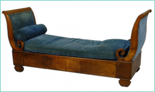 A Walnut upholstered sleigh bed form 19th century France.