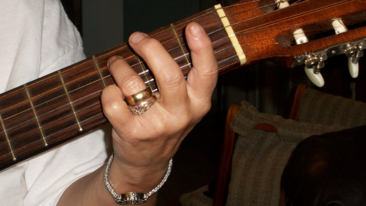 Note C on the 5th string 3rd fret, 3rd ring finger.
