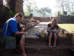 Having samoosa for breakfast on the steps of a church a few hundred years old in Old Goa
