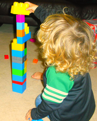 My 2 year old son putting finishing touches to a tower!