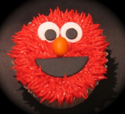 How About Making Some Elmo Cupcakes?!