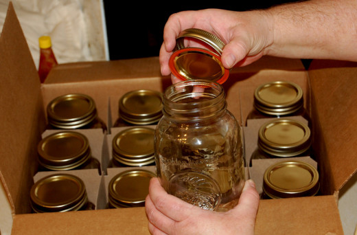 This is an excellent blog for both new and experienced canners :-). A new case of canning jars will come with canning lids and canning rings--the rings are reusable, these lids are not reusable. You can, however, buy reusable canning lids!