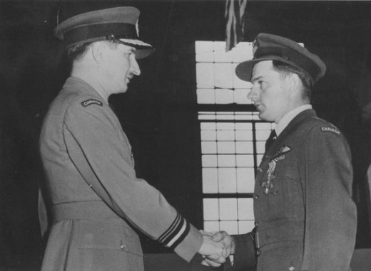 Flight Lieutenant Lloyd Henderson receives his DFC in 1949, four years after it was awarded.