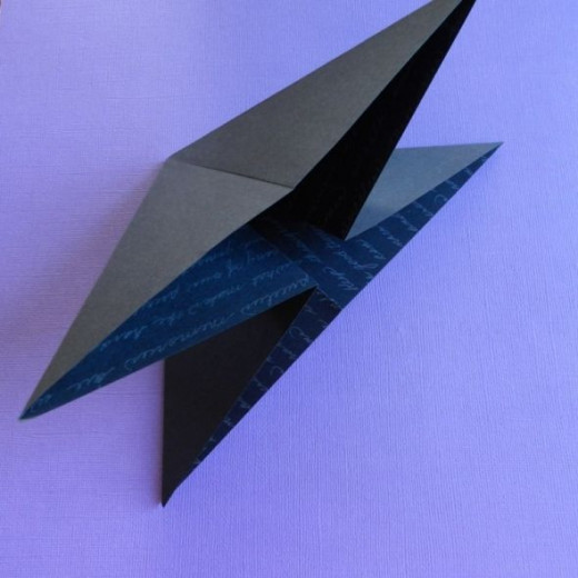 Collapse into a double triangle with two flaps on each side.