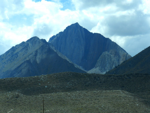 A series of photos from Hwy 395. Highest peak is Mt. Morrison. The rocky front ridge is the end moraine.