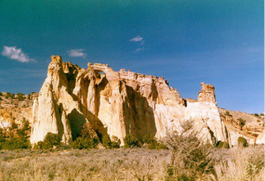 Grosvenor Arch. Look to the right of the left peak, close to the sky. Not easy to see, but huge in real life.