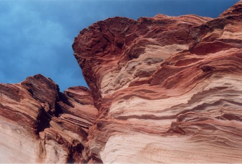 If you are familiar with The Wave and the Coyote Buttes, you can probably see a resemblance to these cliffs.