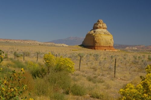 As you approach on a very long straight road through flat land, you see this rock in the distance.