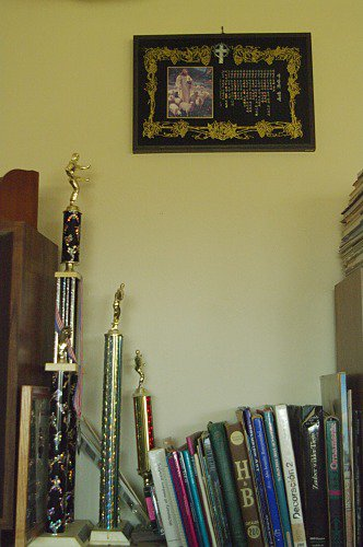 Another view of the room. The picture of Jesus with the sheep (a gift) has inlaid mother of pearl. The trophies are from my taekwondo competitions.
