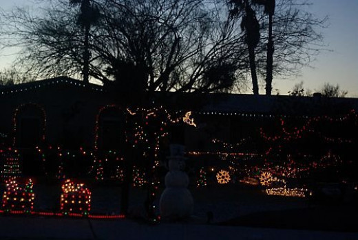 Another year, a display in front of a house, not quite dark.