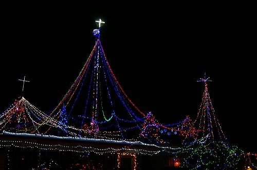 A friend of ours, who is a radio ham, has a lot of antennas on top of his house. Every year he decorates them with Christmas lights.