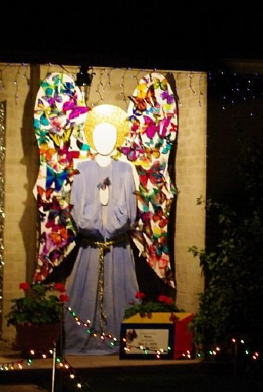 The angel's wings were covered with colorful butterflies.