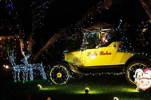 Truly Nolan is a local extermination company. They have these vintage autos, painted yellow with red letters. They also have VW bugs with ears and a tail, to look like a mouse. In this display, reindeer are pulling the auto.