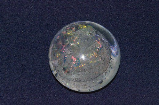 Glass ball with bubbles and iridescent flakes, probably from Italy