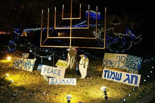 Menorah, in celebration of Chanukah, with signs. Notice he has two of the lost penguins.