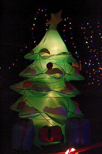 Funky Christmas tree next to the bubble blowing machine.