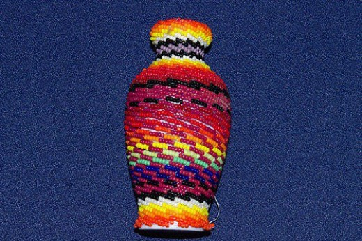 Vase covered in Indian beads