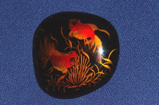 Lacquered stone from Viet Nam, showing two goldfish.