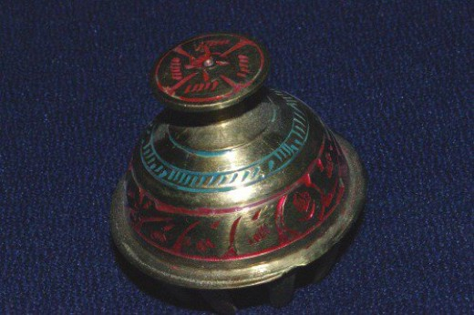 Brass bell with painted decorations