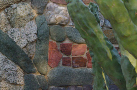 The wall is made up of different interesting rocks.