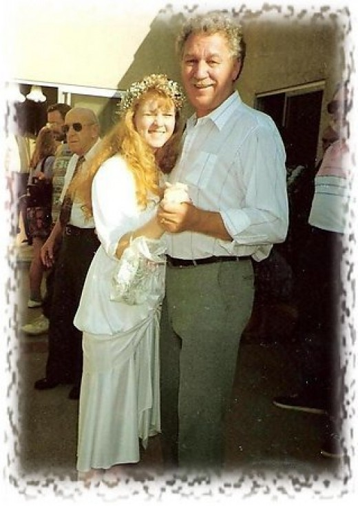 My stepdad dancing with me at my wedding