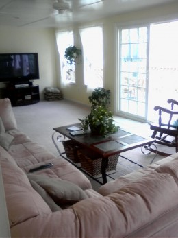 The conversion from covered porch to sun room allowed this space to double as a family room.