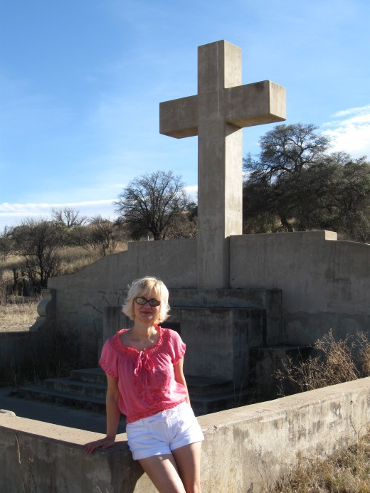 My wife posing in front of monument to Fray Marcos de Niza, the explorer and first European to enter Arizona. (Coronado National Forest, Arizona)