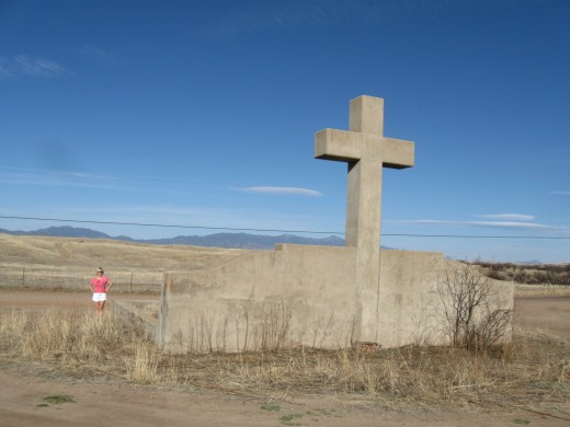Cross towering above the monument to the Spanish priest and explorer Fray Marcos de Niza in Coronado National Forest in Arizona.