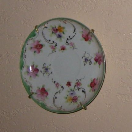 This saucer is missing its cup so on the wall it goes!