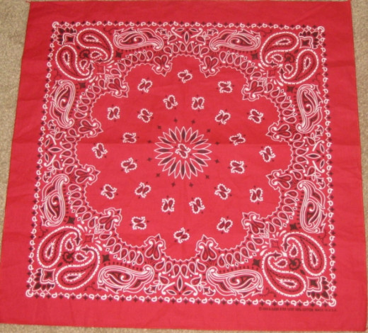 Classic red bandana with paisley designs.