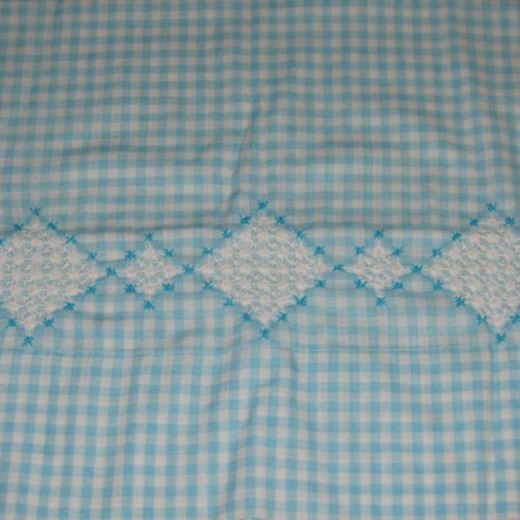 There are lots of names for this stitch including chicken scratch, Depression lace, snowflaking, and gingham embroidery.