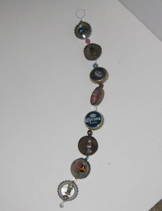 I made a bottle cap strand with bottle caps I found with my magnet.
