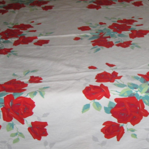 Red rose designs on vintage cotton tablecloth.