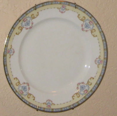 This lovely dessert plate hangs on my wall. It is the first quiz question.