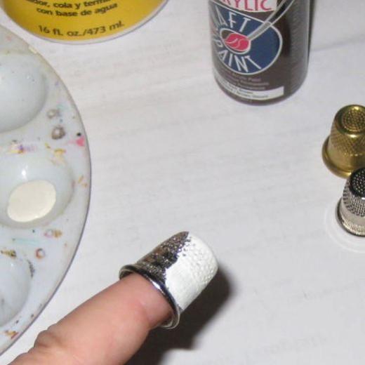Paint the thimbles white.