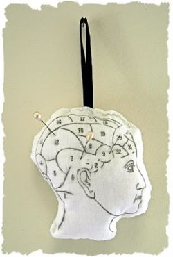 Phrenology pin cushion. Download the clip art at The Graphics Fairy.