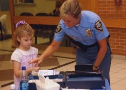 Child and police officer.
