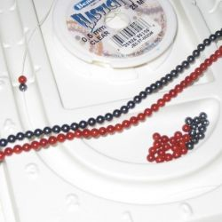 Gather the beads and elastic. A bead tray helps for laying out the beads.