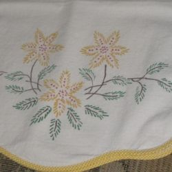 Dresser scarf with paint embroidery.