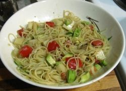 Pasta salad can be made ahead and eaten with bread and fruit for a delicious easy meal.