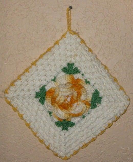 Raised flower crocheted potholder