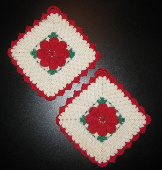 Pair of vintage potholders with red flowers.
