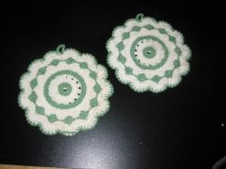 Pair of vintage potholders in green and white.