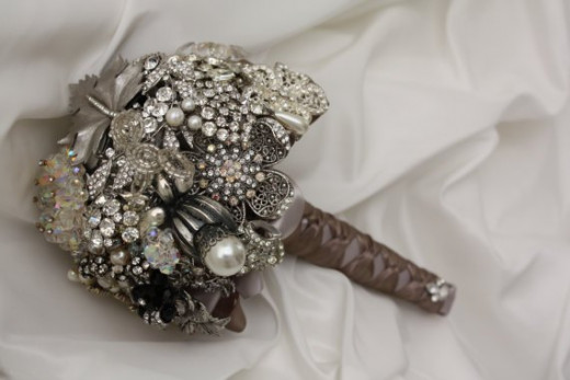 Bridal bouquet with vintage brooches by Etsy seller Nancy Hendrix (baublesandbrides). See the link below to visit her Etsy listing for this lovely alternative bridal bouquet.