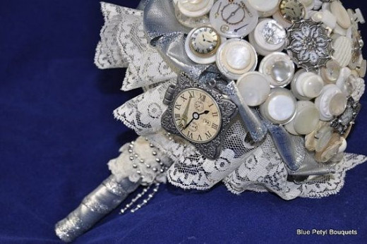 This Steampunk bridal bouquet by BluePetyl on Etsy features vintage buttons, watch and clock parts, and more. See the link below to see this bouquet on Etsy.