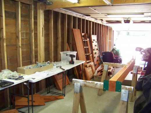 """I don't like to """"cook"""" in the sun, so I setup a workshop in my garage to assemble pieces of the wooden swing set."""