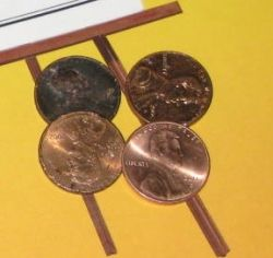 Pennies lined up in a row. Hope there's no row over who's shinier.