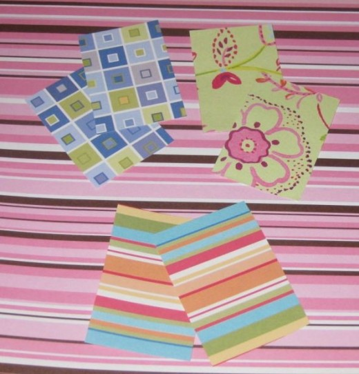 Cut out scrapbook paper using the top and bottom of the matchbox as a template.