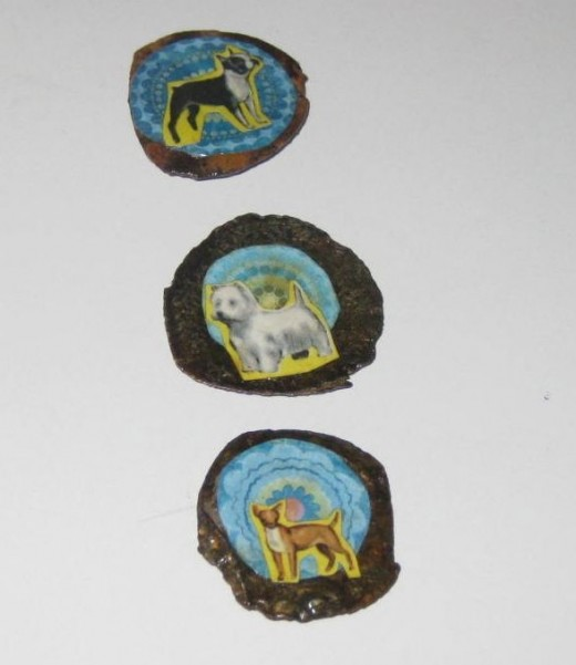 Dog Magnet Set made with rusty, mangled, flat bottle caps.